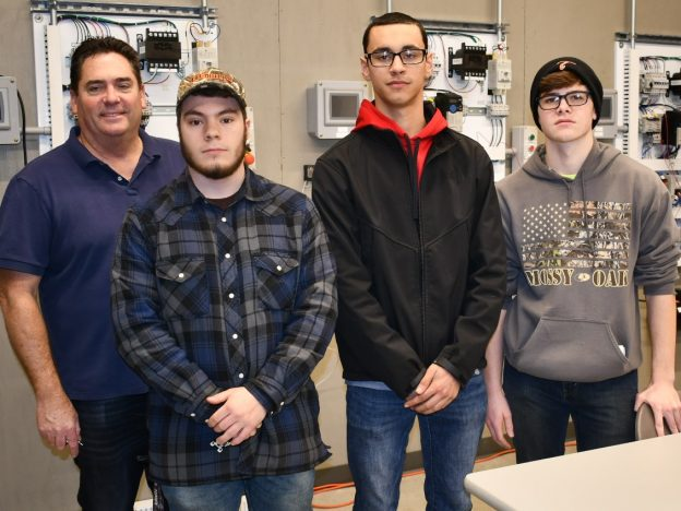 Job shadowing provides hands-on learning for those exploring electrician apprenticeships